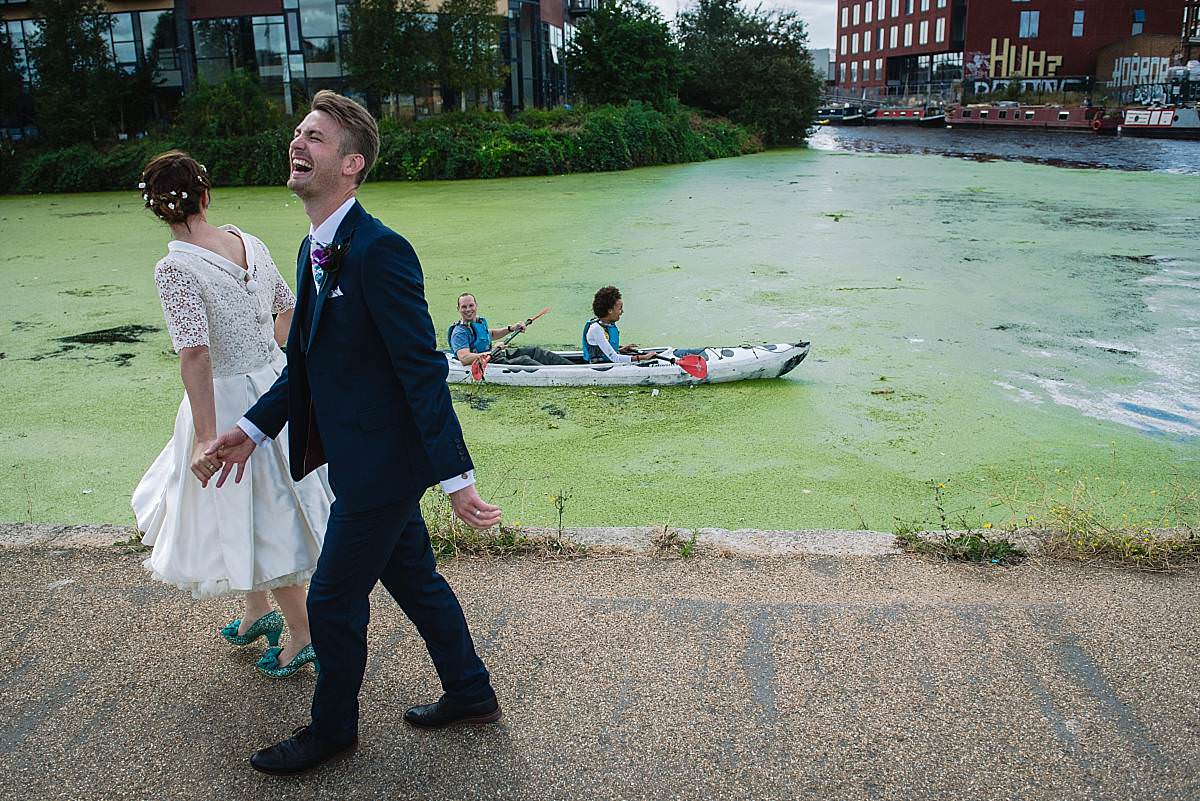 Stour Space wedding couple walking along canal
