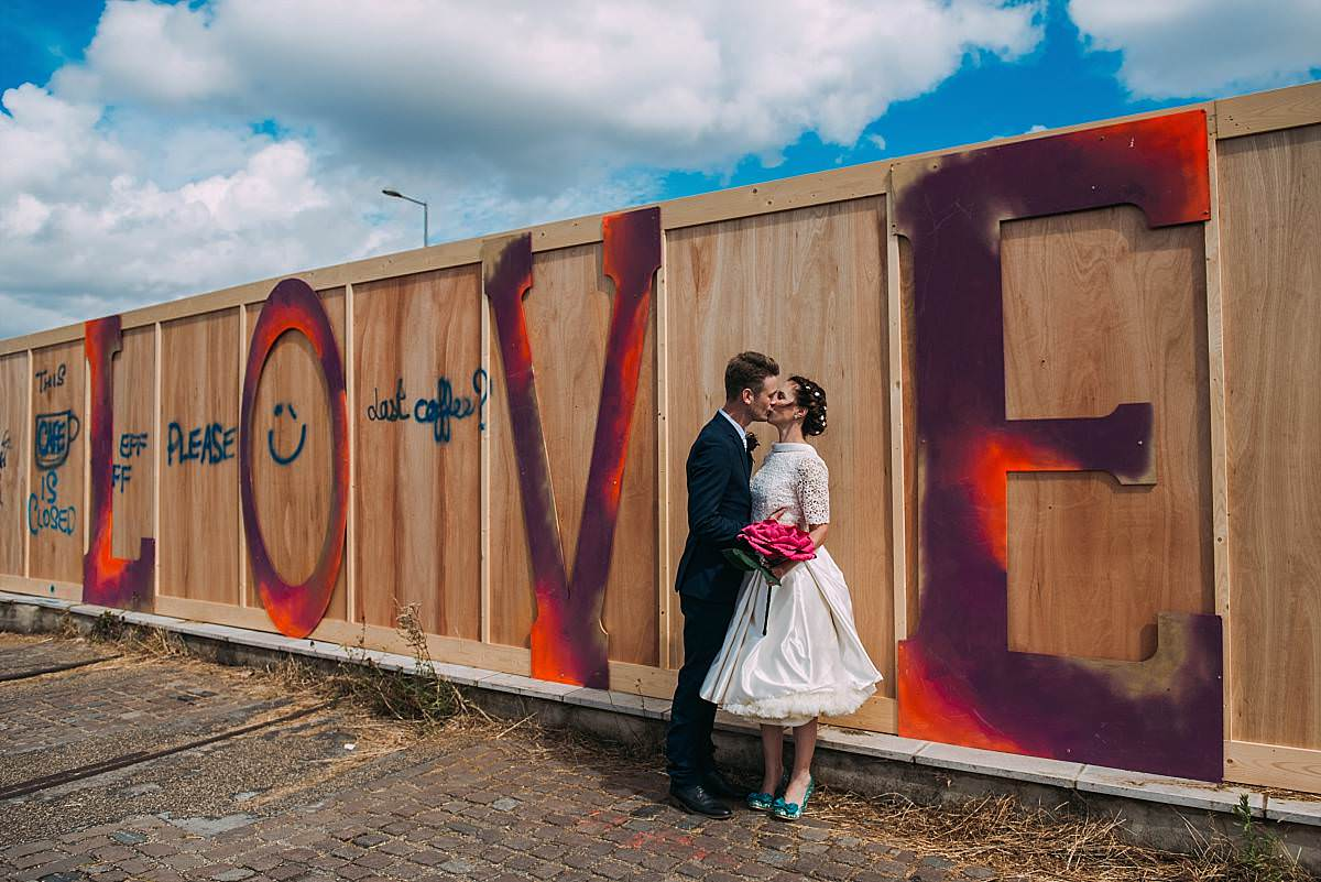Stour Space wedding couple kissing by love signage