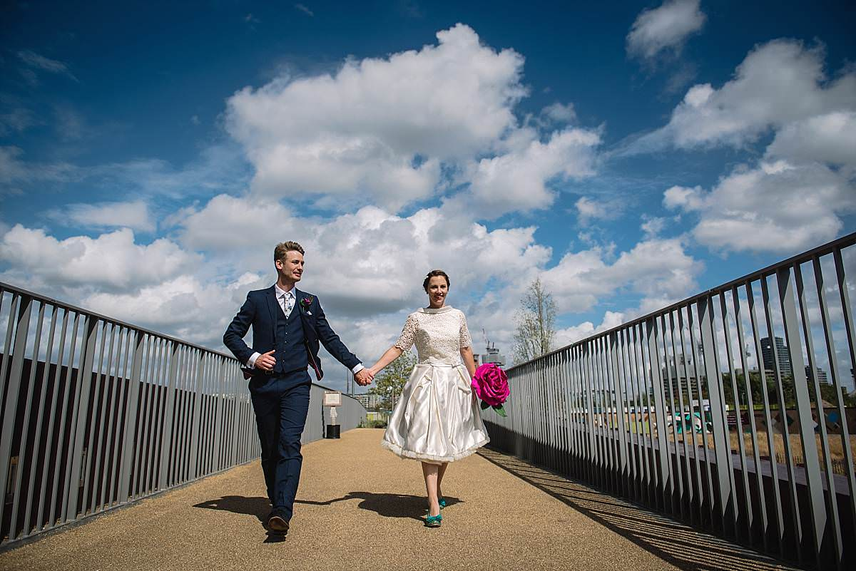 Stour Space wedding couple holding hands walking