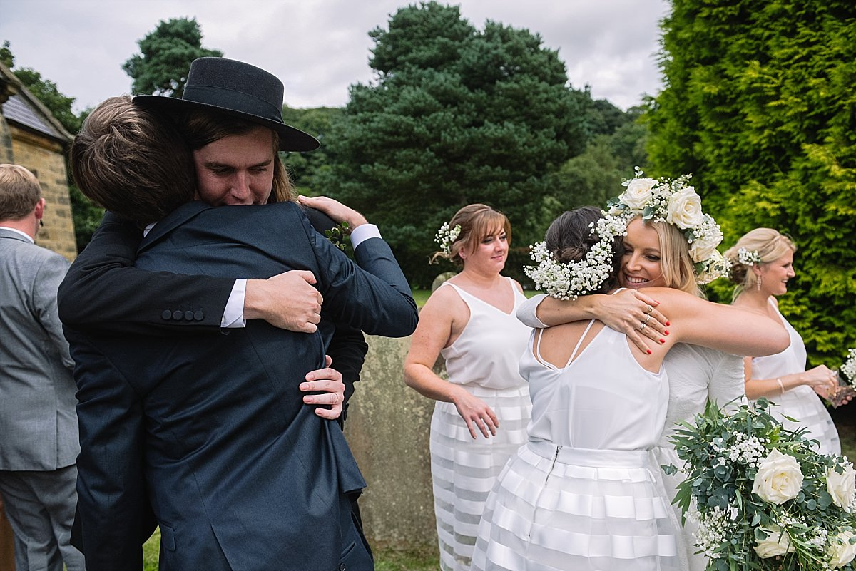 Bride and groom hugging guests a Yorkshire wedding