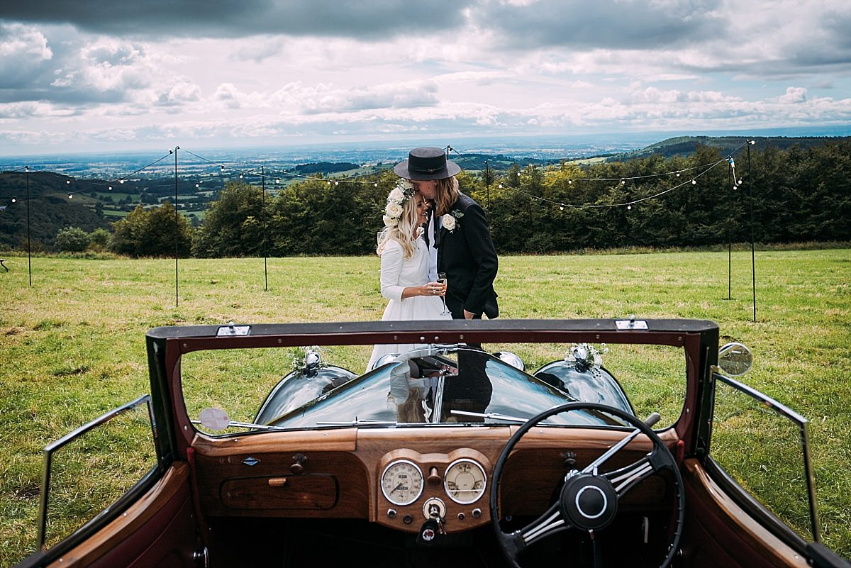 Couple with classic car at High Paradise Farm wedding in Yorkshire