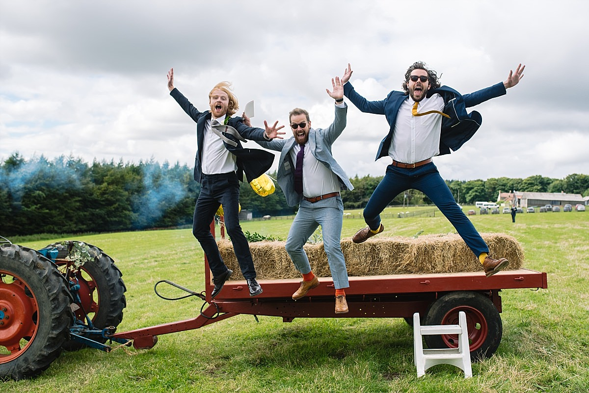 Jumping off a tractor at High Paradise Farm wedding