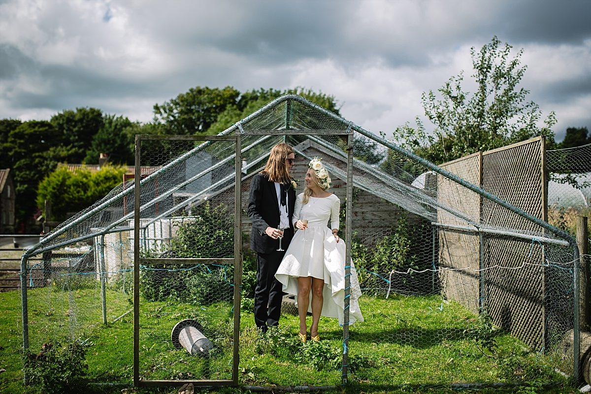 Bride and groom in chicken coop at High Paradise Farm wedding