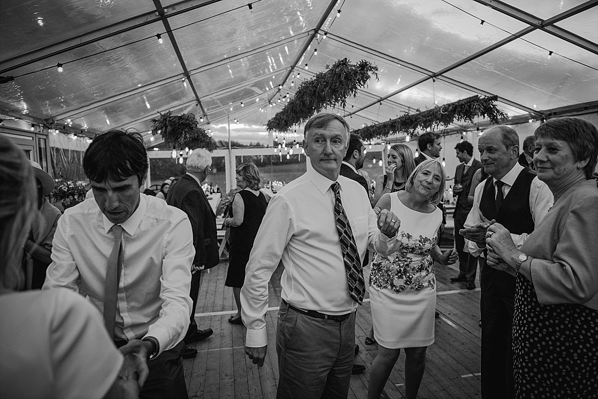 Candid photo of guest dancing at High Paradise Farm wedding