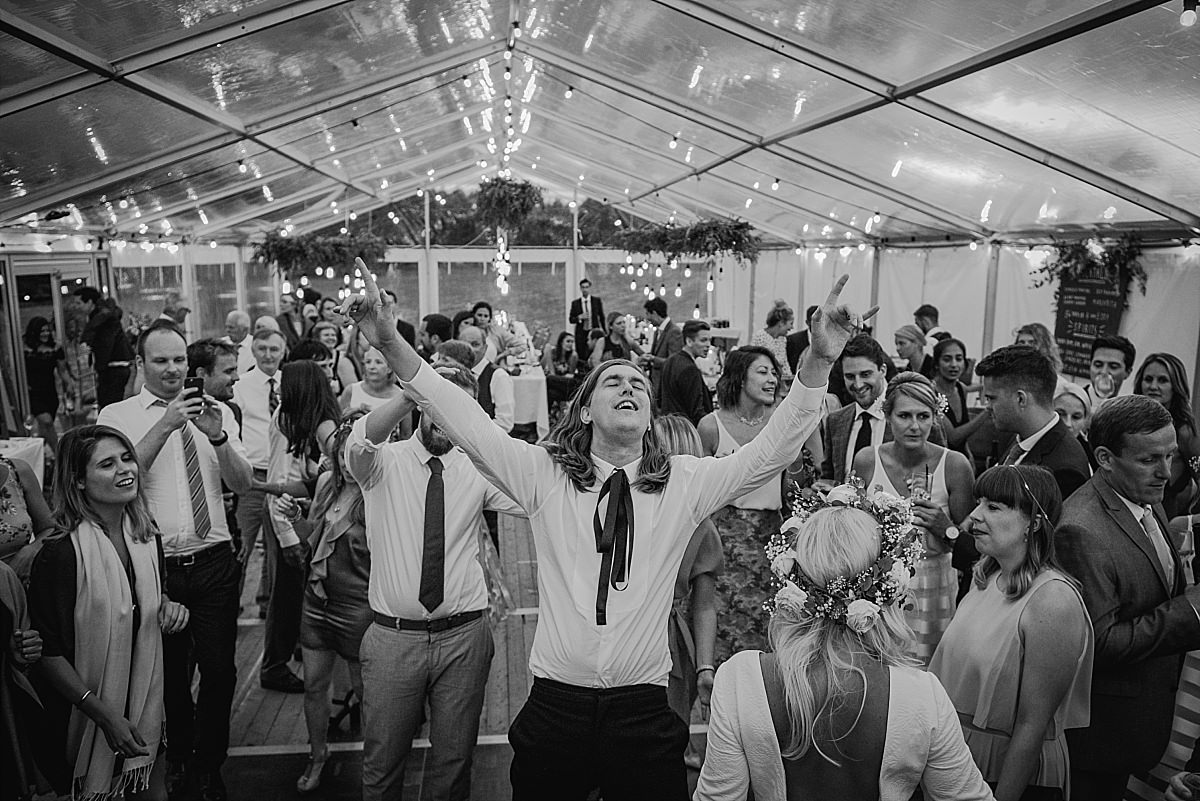 Groom feeling the music at High Paradise Farm wedding