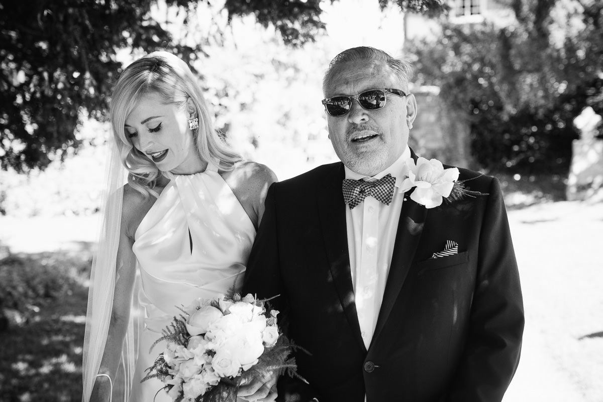 Bride with father arrive for ceremony at Cranborne church
