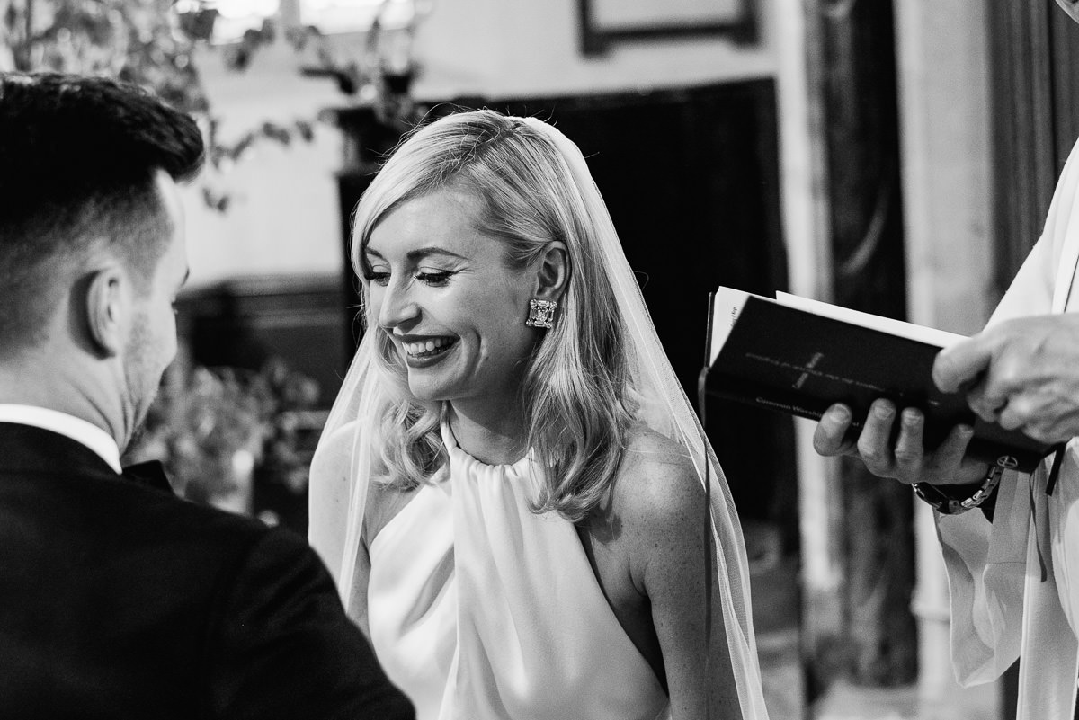 Bride and groom laughing during ceremony at Cranborne church