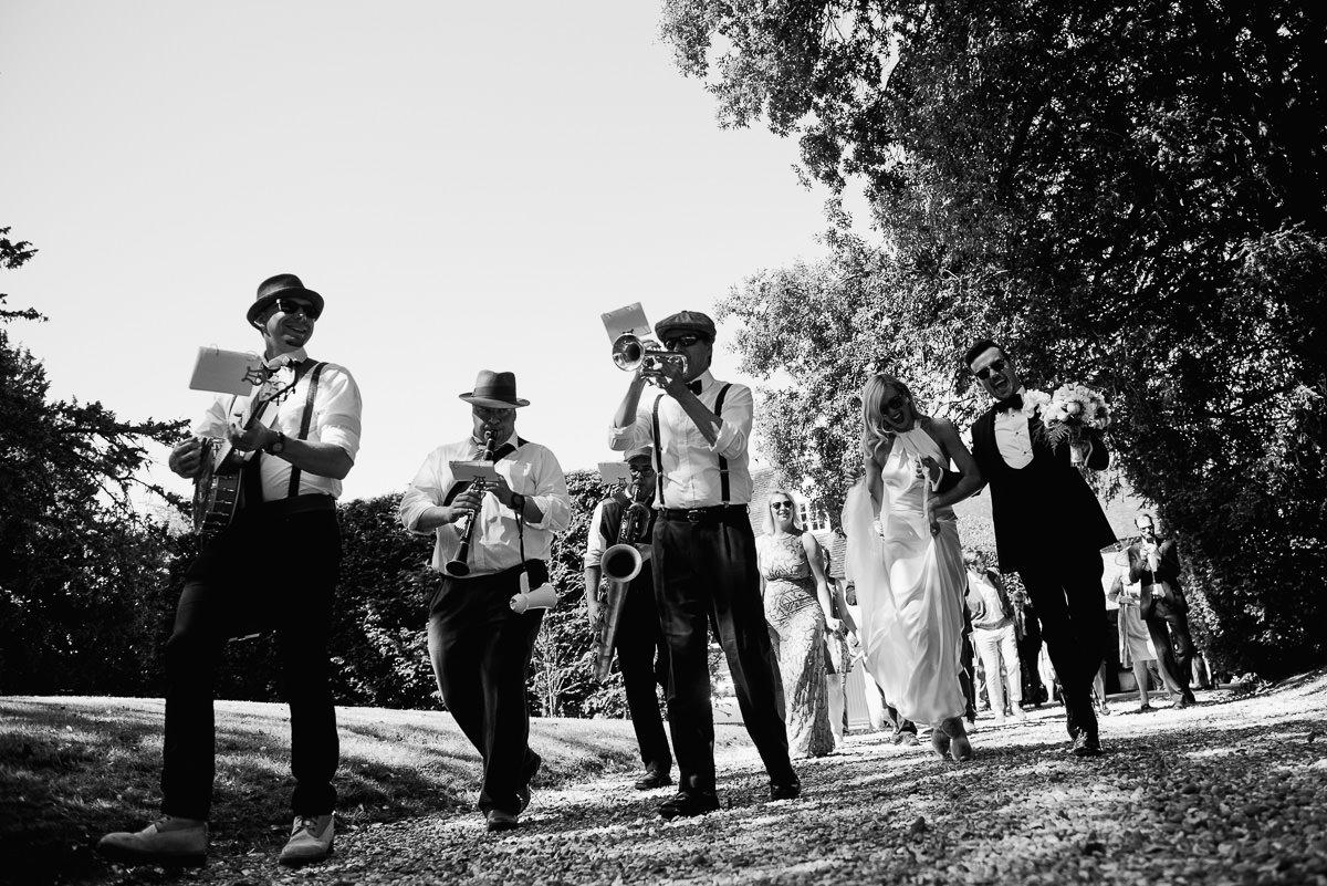 The Tin Pan Alleys walk bride and groom to Cranborne wedding venue