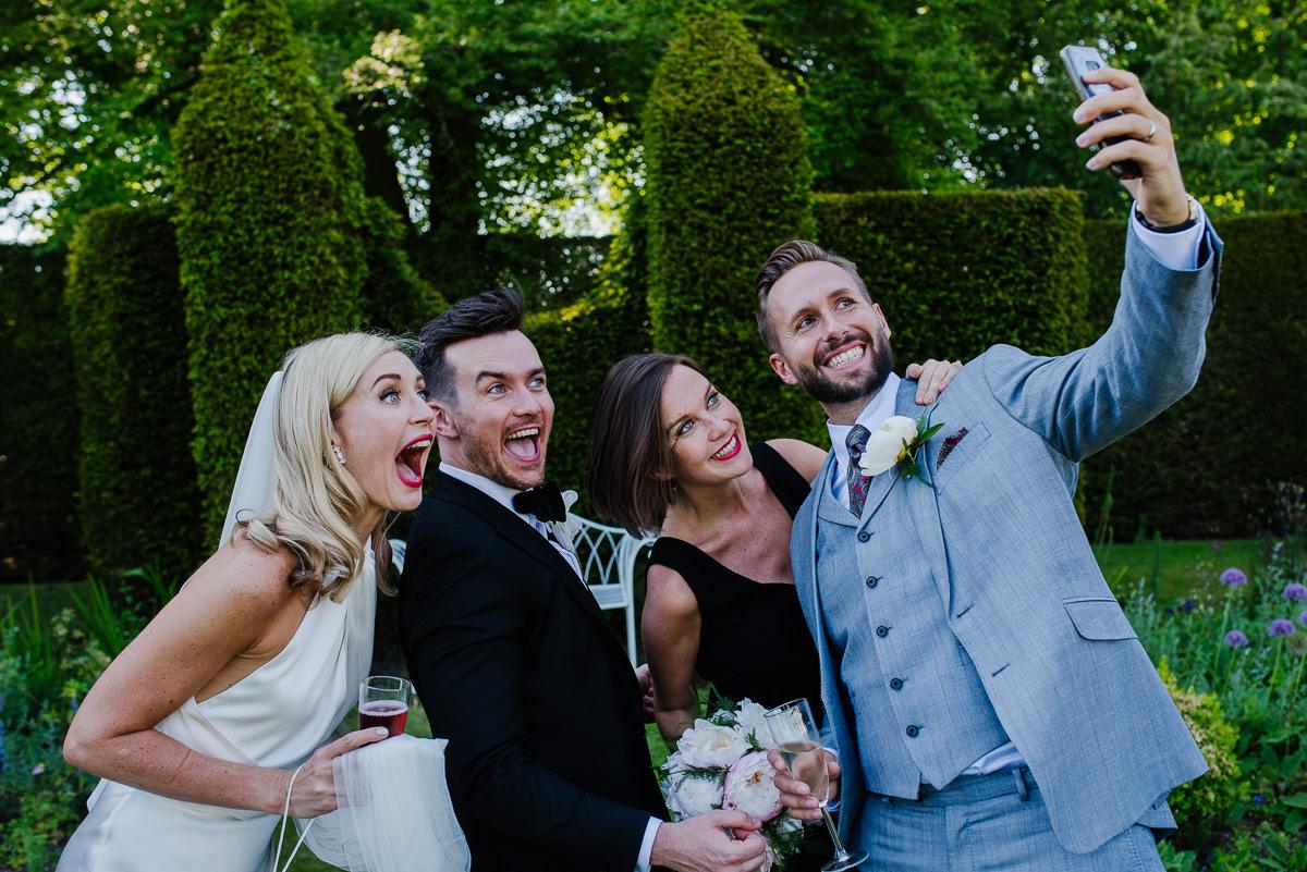 Guests take a selfie at 10 Castle street Cranborne wedding photos