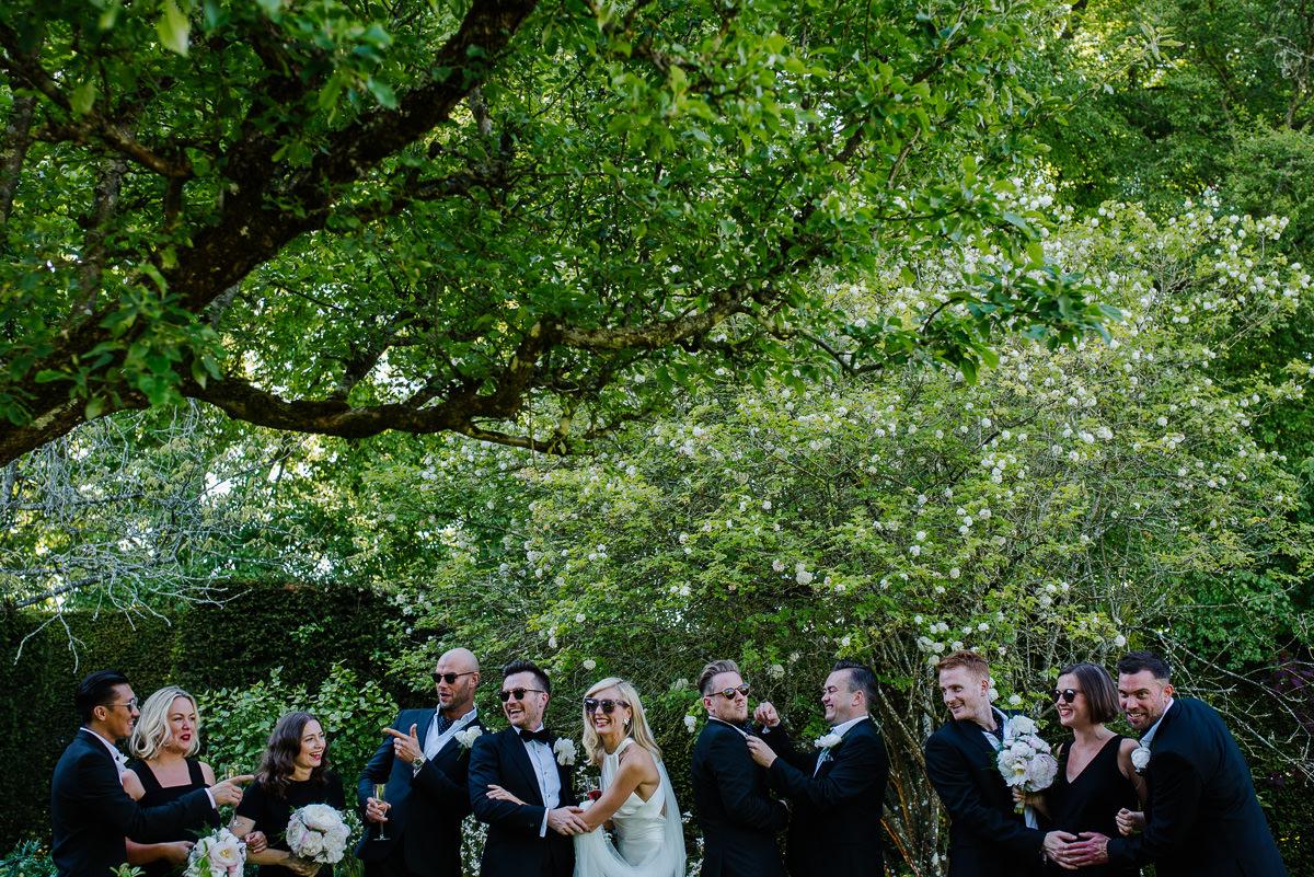 bridesmaids and groomsmen in garden at 10 Castle street Cranborne wedding photos