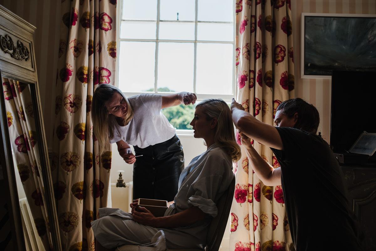 Bridal preparations during 10 Castle Street Cranborne wedding photos