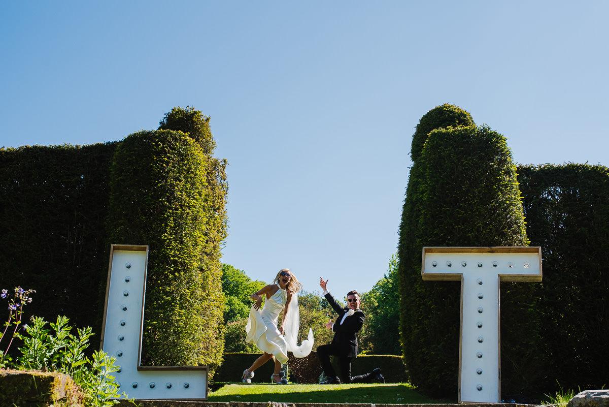 bride and groom in garden at 10 Castle street Cranborne wedding photos