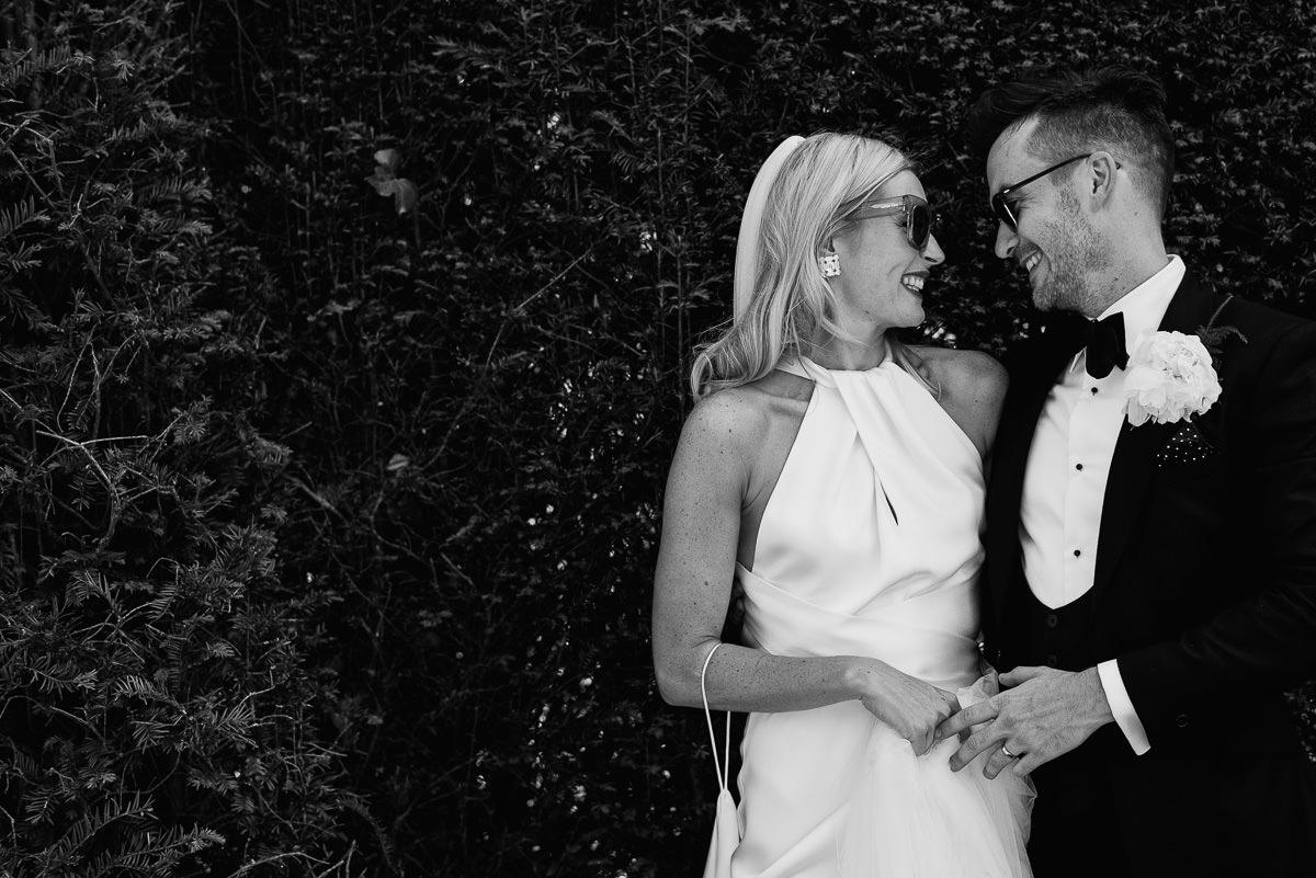 bride and groom hugging in garden at 10 Castle street Cranborne wedding photos