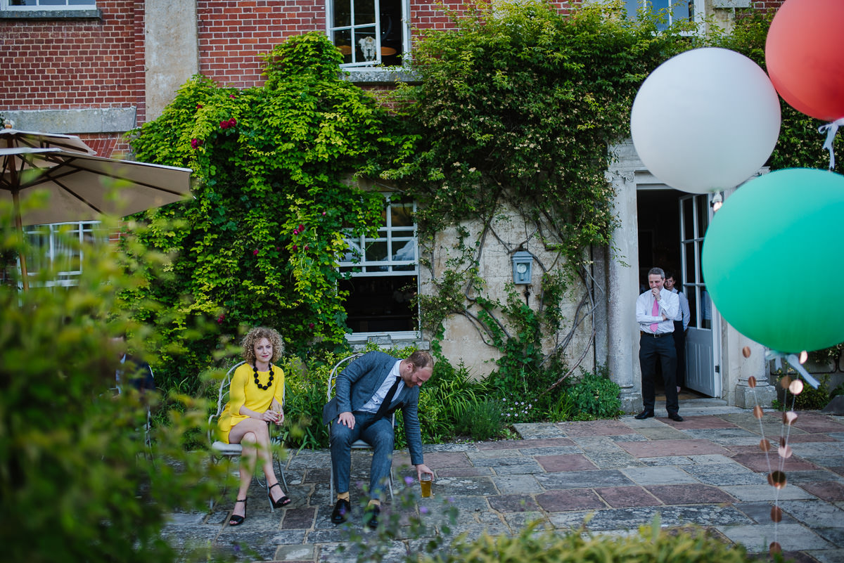 Guests and colourful balloons at 10 Castle street Cranborne wedding photos