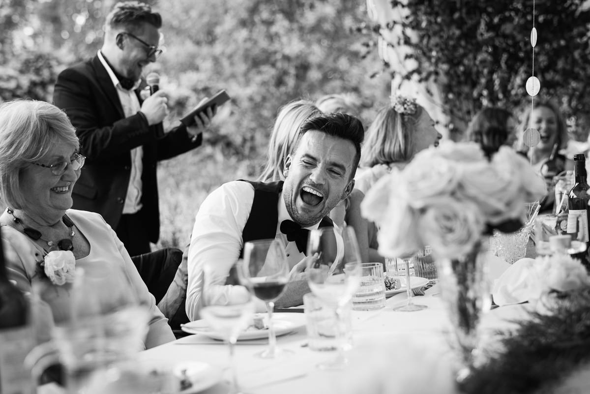 Groom laughing during speeches at 10 Castle street Cranborne wedding photos