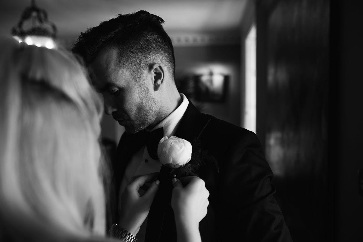 Groom having buttonhole fixed during 10 Castle Street Cranborne wedding photos