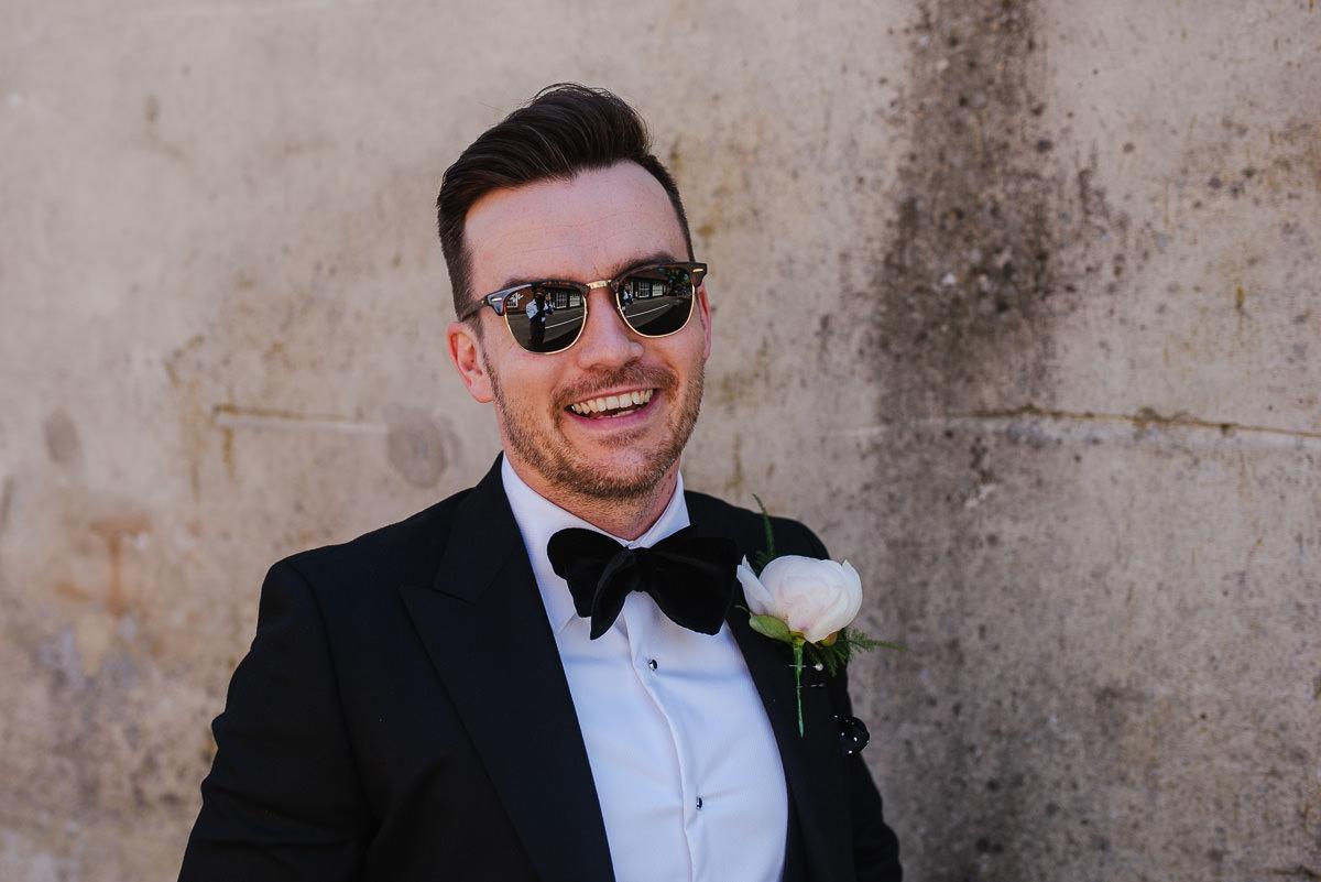 Groom wearing sunglasses and suit at 10 Castle Street Cranborne wedding venue