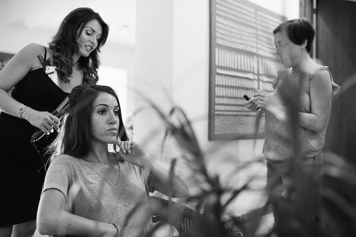 Bride having her hair done before traditional Greek wedding ceremony