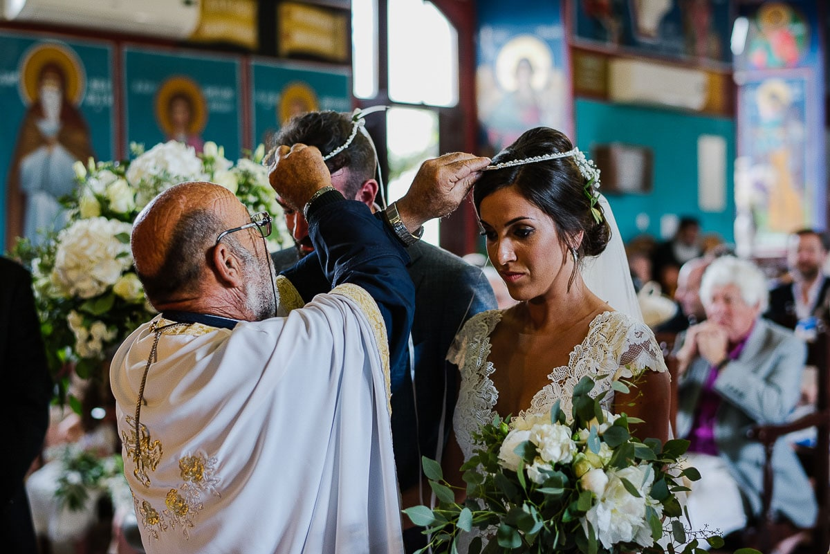Bride and Groom swap crowns during ceremony in Agios Minas Church in Cyprus