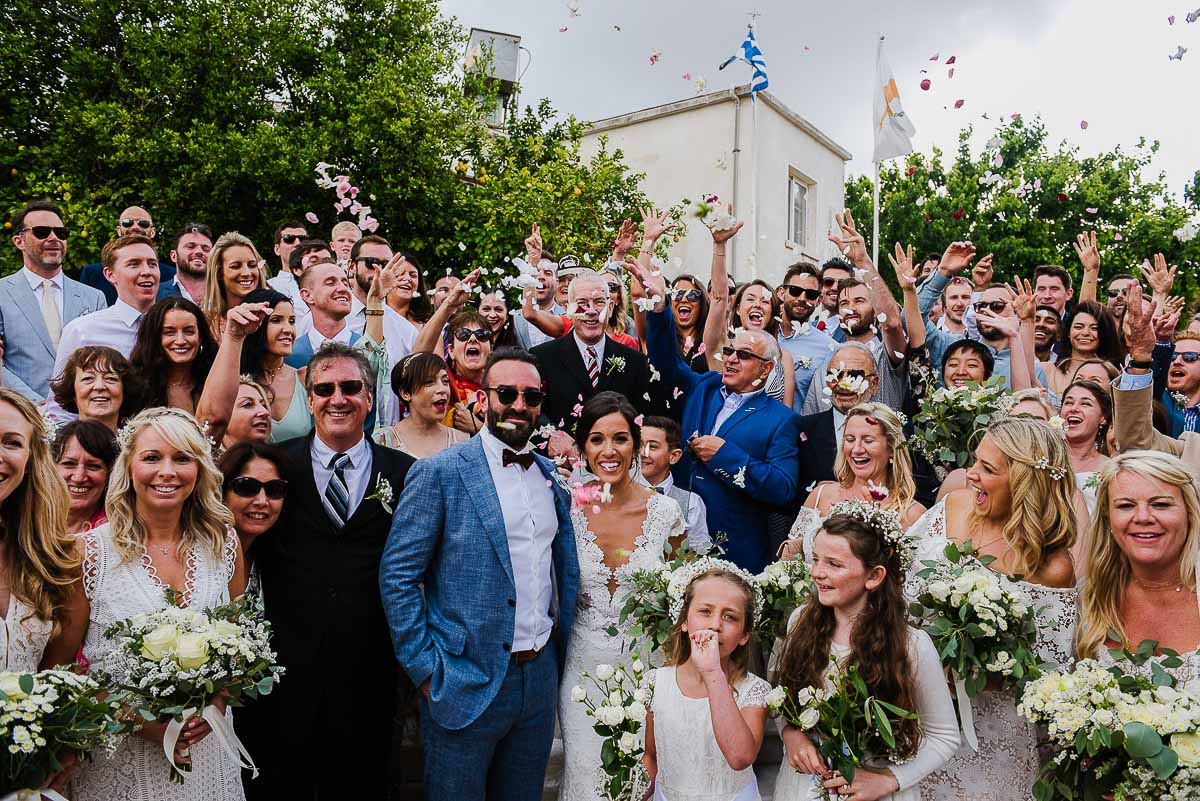 Bride and Groom with wedding guests outside Agios Minas Church in Cyprus