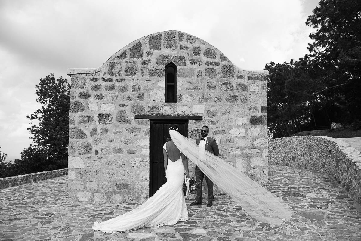 Bride and Groom portraits outside small hillside chapel in Cyprus