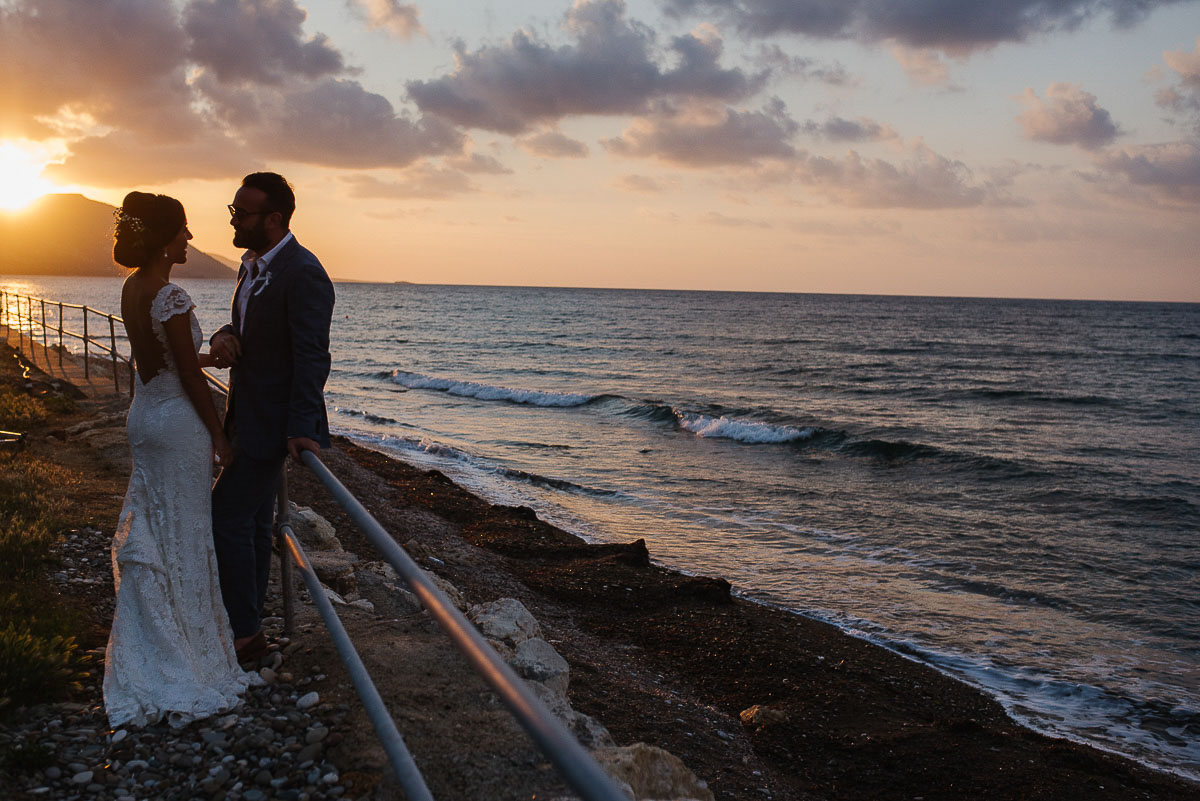 bride and groom silhouetted against the sunset at Souli beach hotel wedding venue