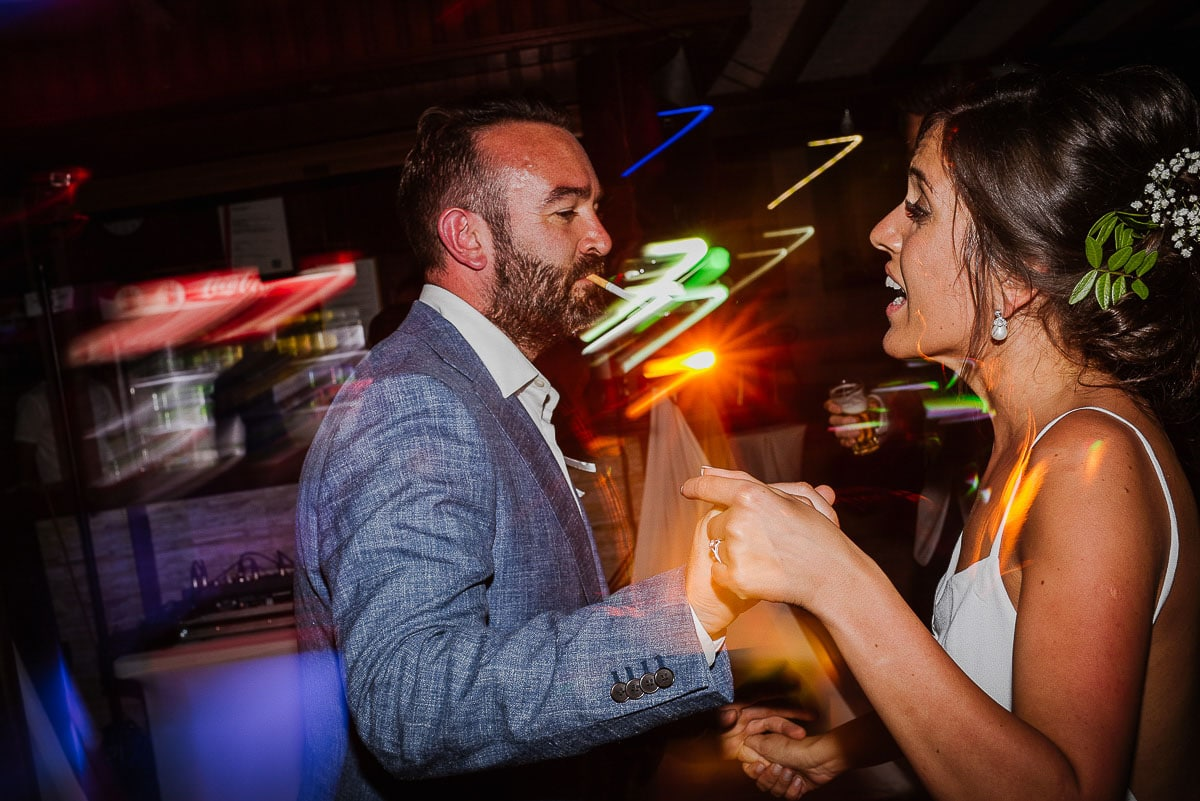Groom with cigarette and bride dancing during Souli beach hotel wedding part