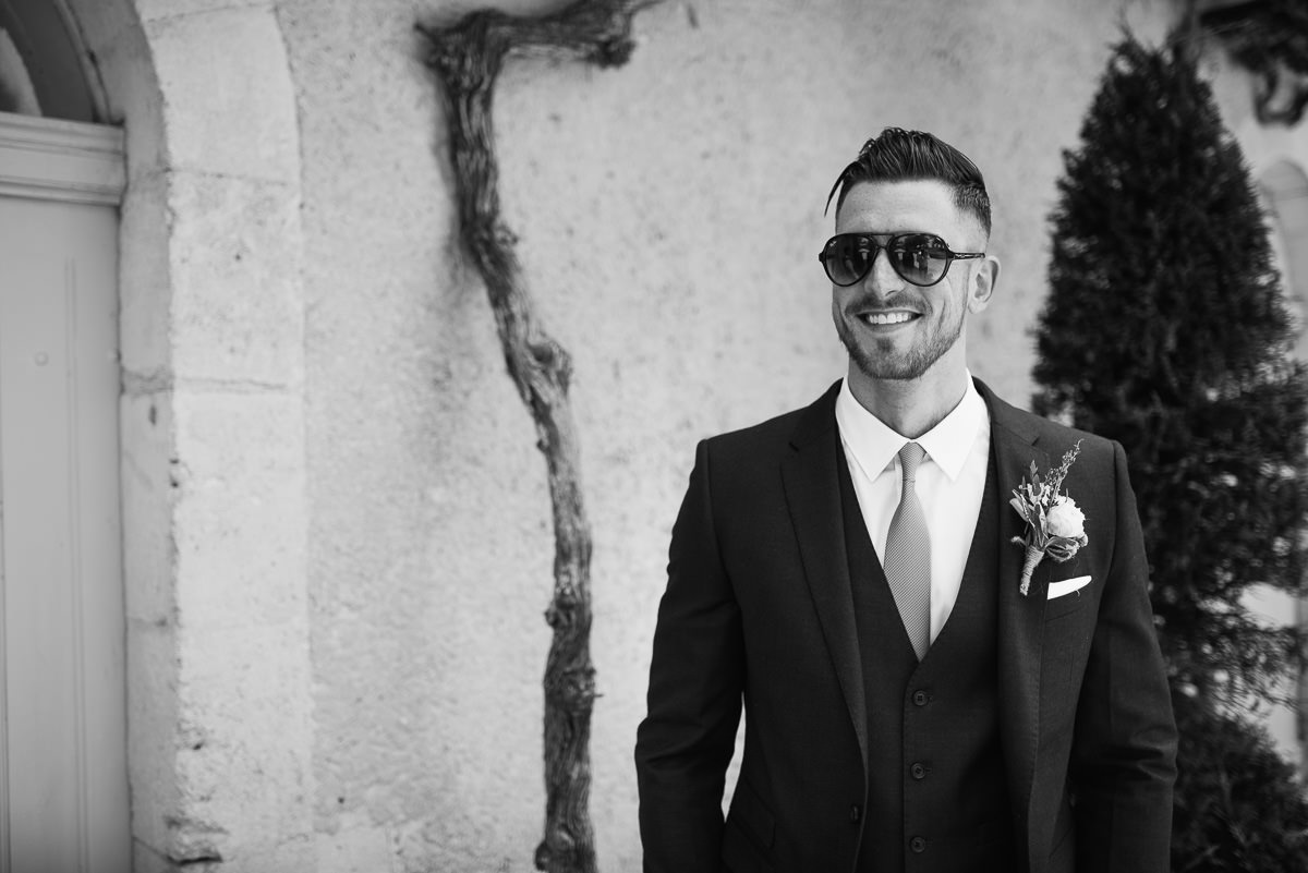 Groom in sunglasses and suit in France