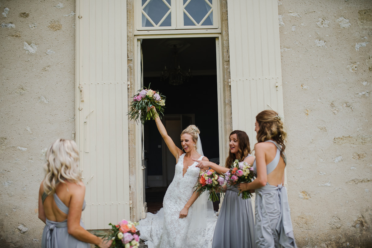 Bride with her bridesmaids outside chateau Soulac in Dordogne France