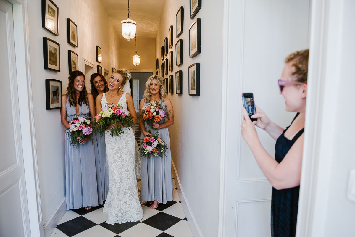 Bride with her bridesmaids in hallway at chateau Soulac in Dordogne France