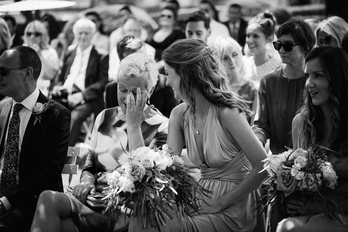 Emotional mother of the bride outdoor ceremony chateau Soulac Dordogne wedding photos