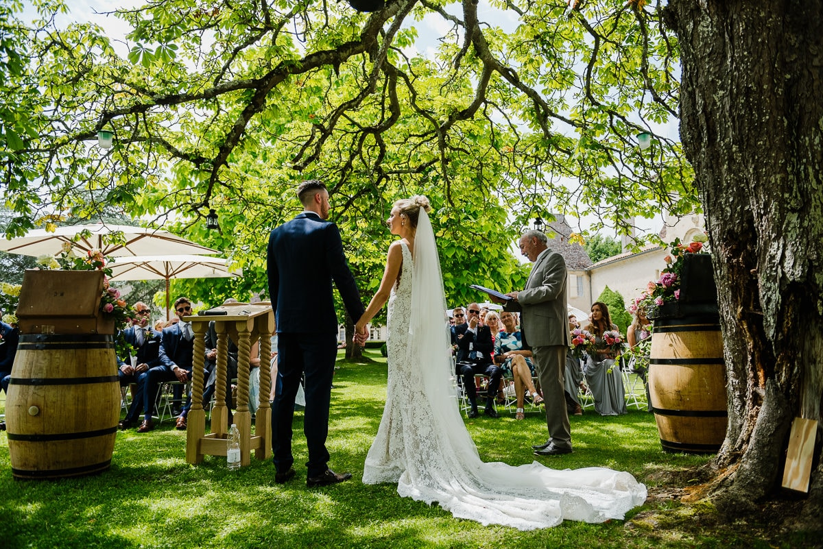 Outdoor ceremony under trees chateau Soulac Dordogne wedding photos