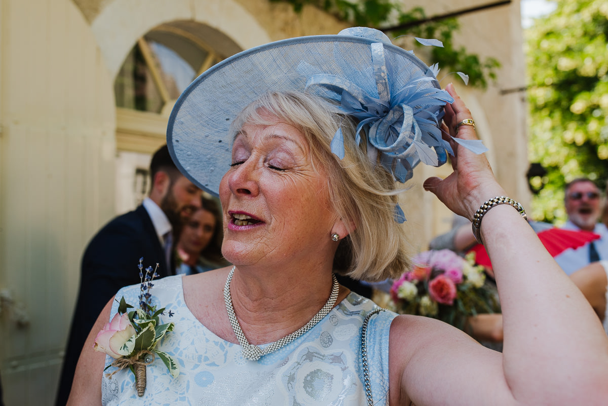 Wedding guest with a lovely hat and necklace in France