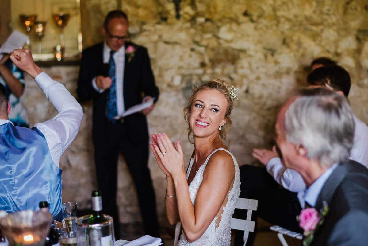 Bride smiling during father's speech Dordogne wedding photos France