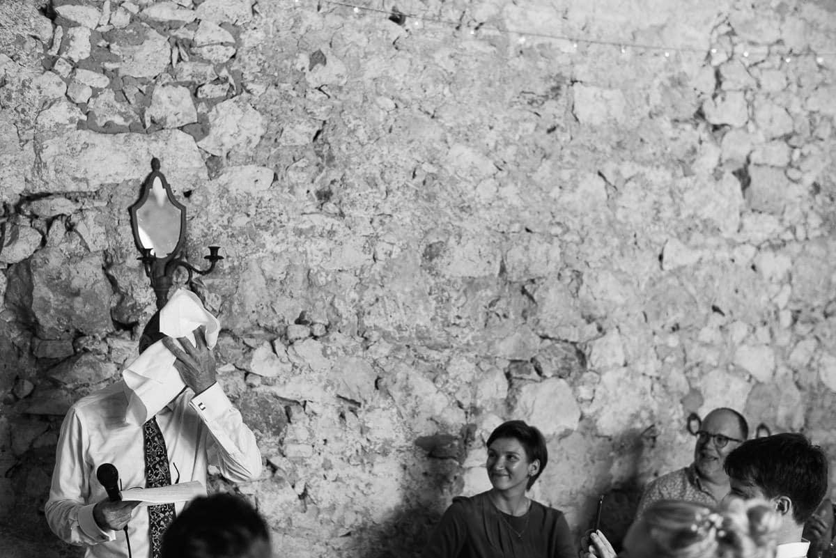 Father of the bride using hankerchief Dordogne wedding photos France