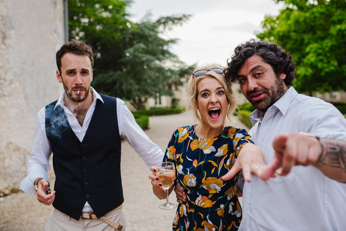 Guests drinking and smoking outside Dordogne wedding photos France