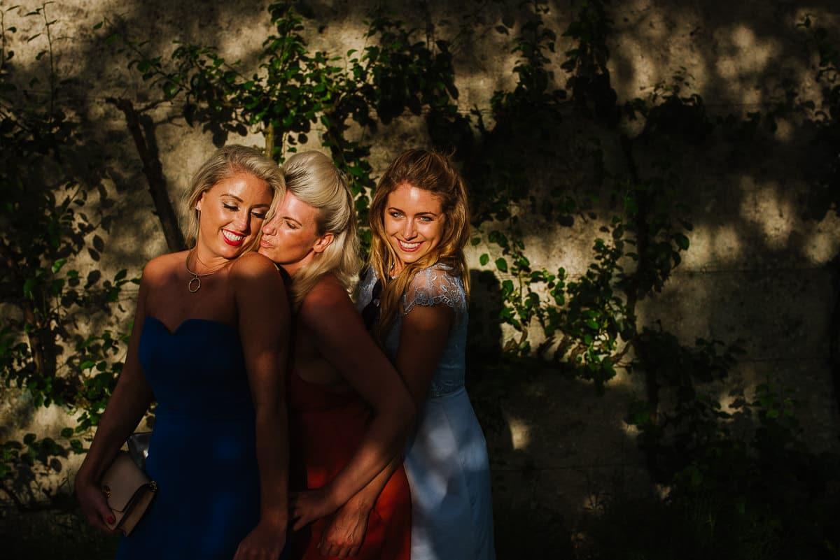 Three guests in evening sun Dordogne wedding photos France