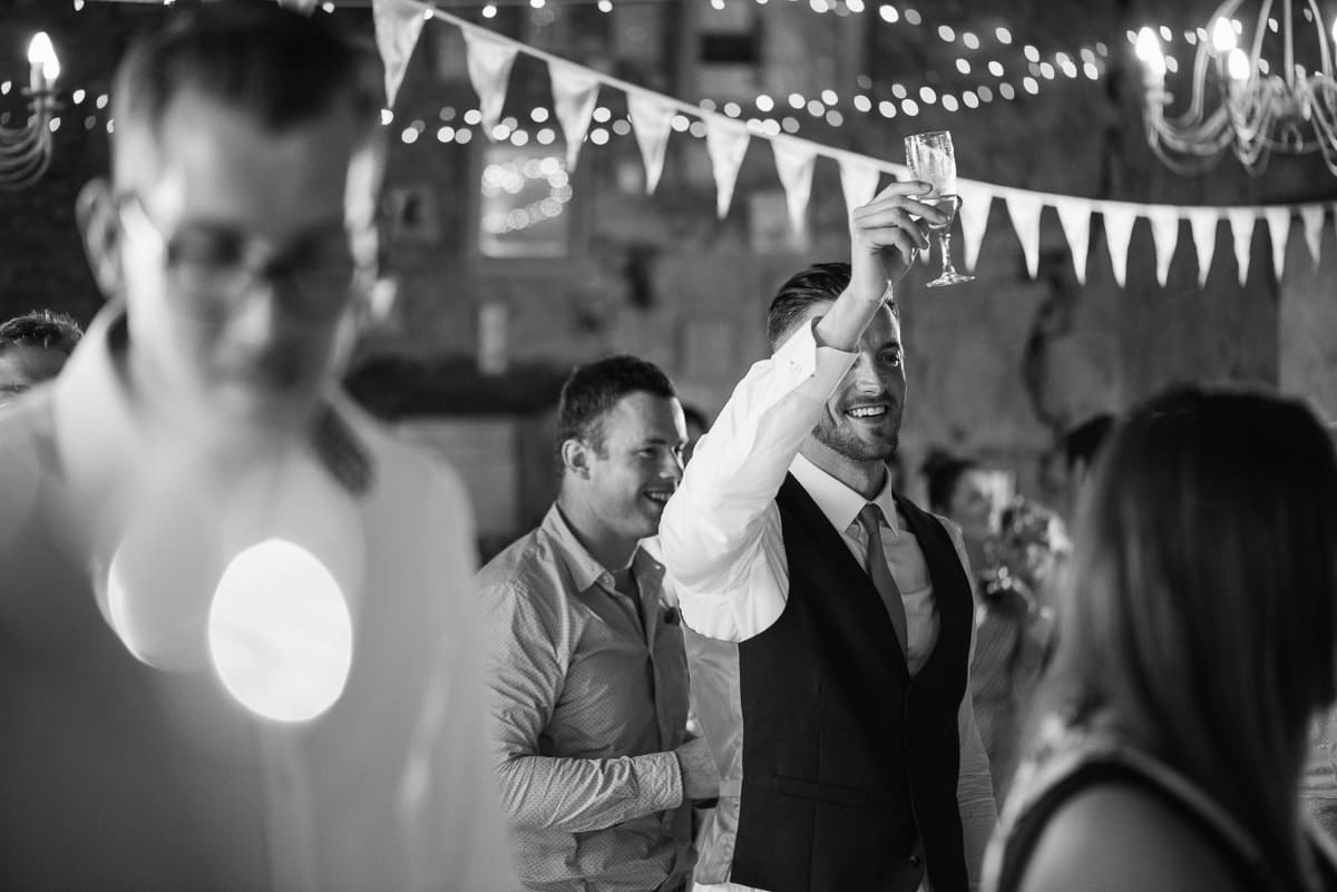 Raising a glass of champagne Dordogne wedding photos France