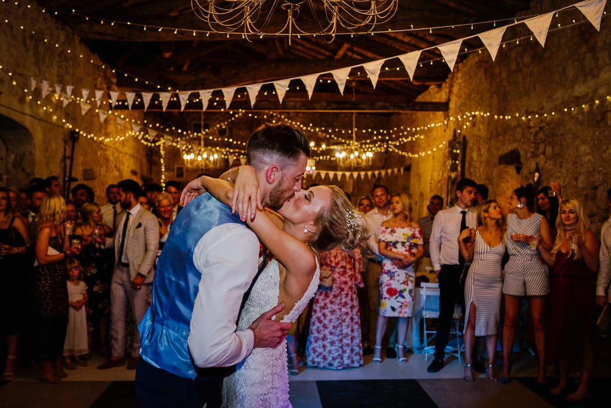 Kissing on dancefloor chateau Soulac Dordogne wedding photos France