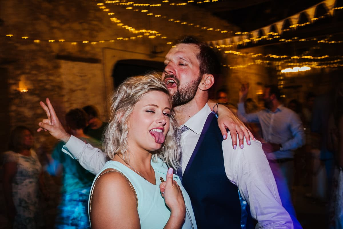 Guests dancing sticking out tongue chateau Soulac Dordogne wedding photos France