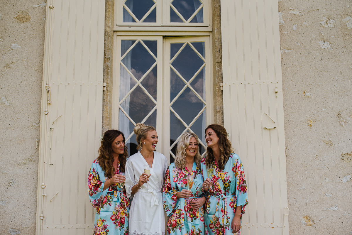 Bridemaids with bride in kimonos at Chateau Soulac Dordogne wedding photos