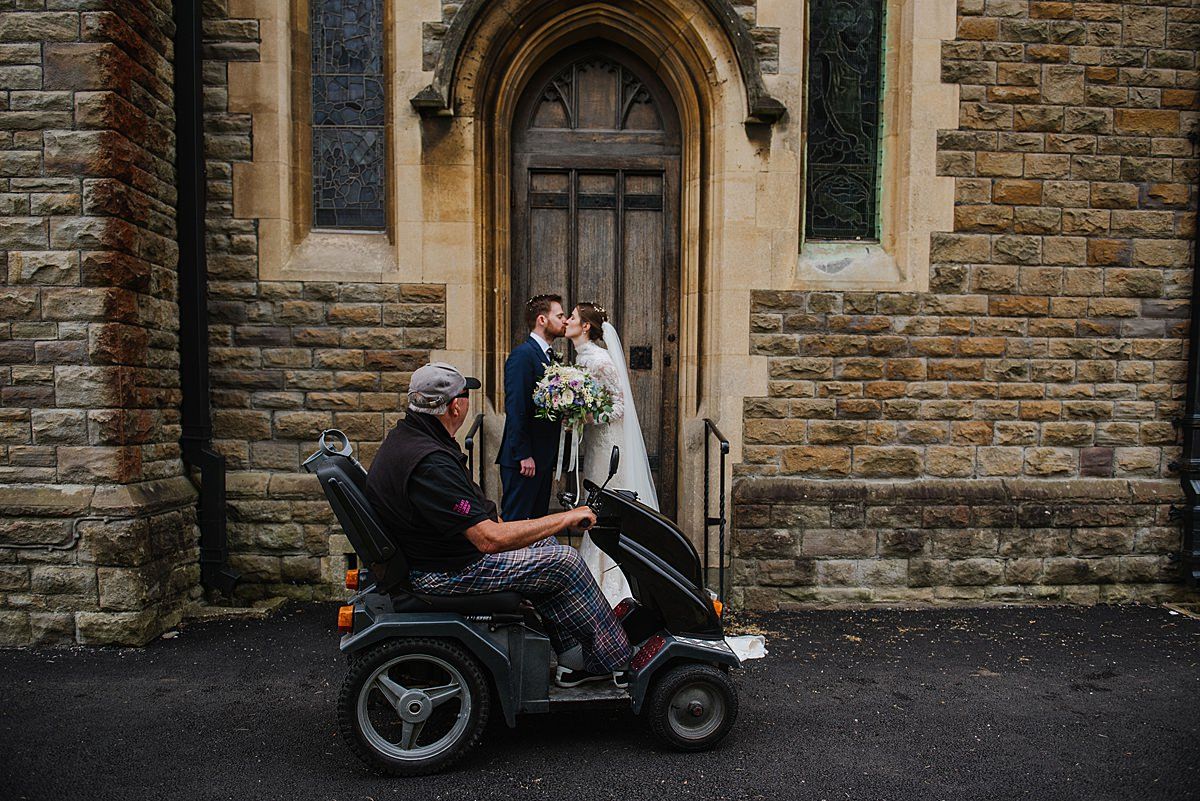 Bride and groom photo All Saints Church in Mumbles