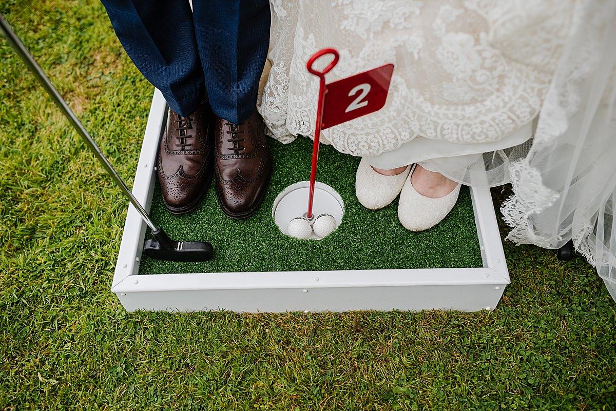 Bride and groom crazy golf Penmaen House Wedding photo