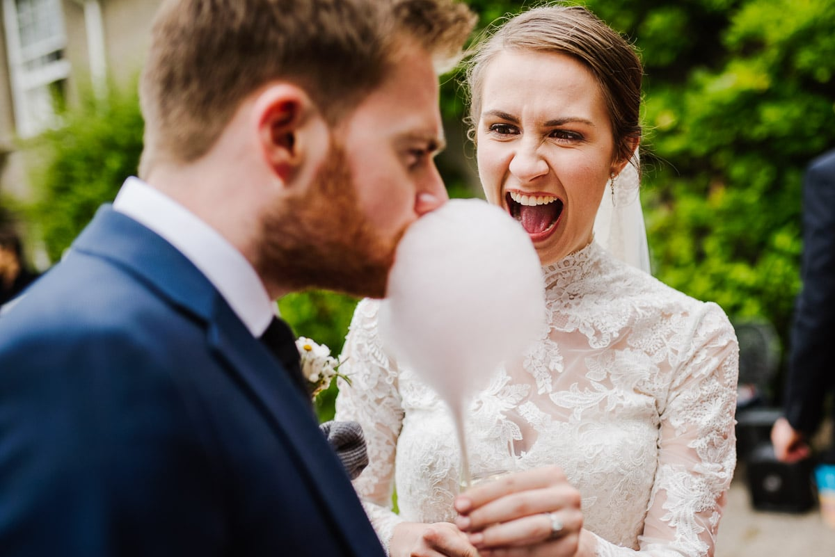 Couple eating funfair candy Penmaen House Wedding photo