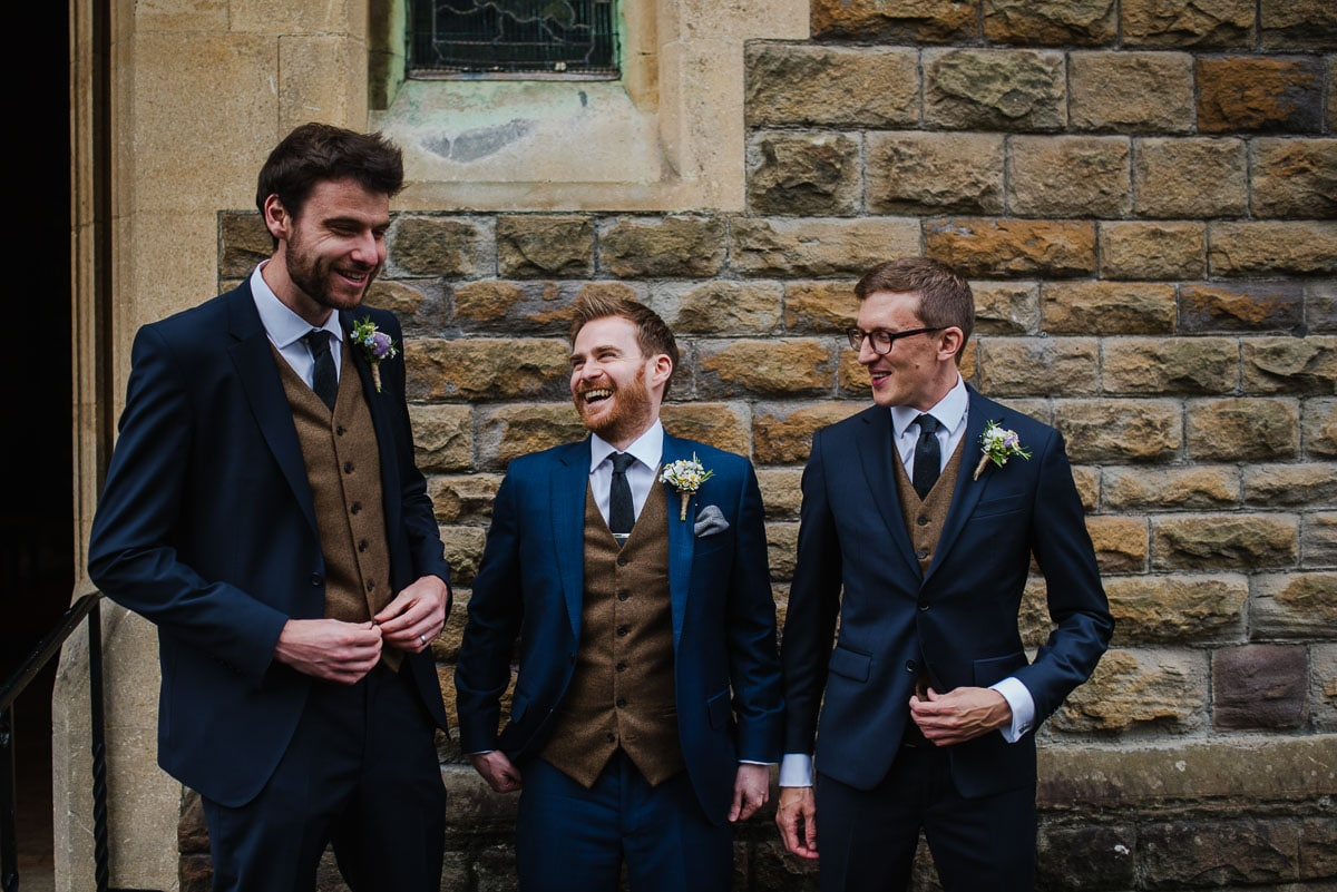 Groom and groomsmen wearing navy suits from Hackett