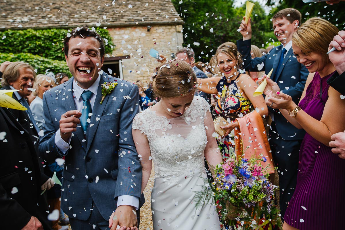 Confetti showered on bride and groom Owlpen Manor