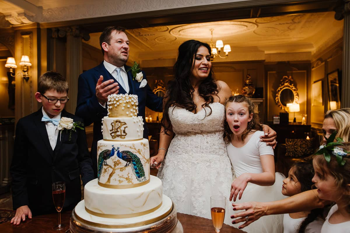 Cutting the wedding cake with children
