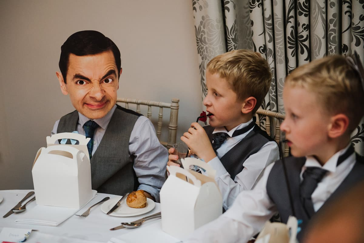 Mr Bean comedy mask worn by wedding guest