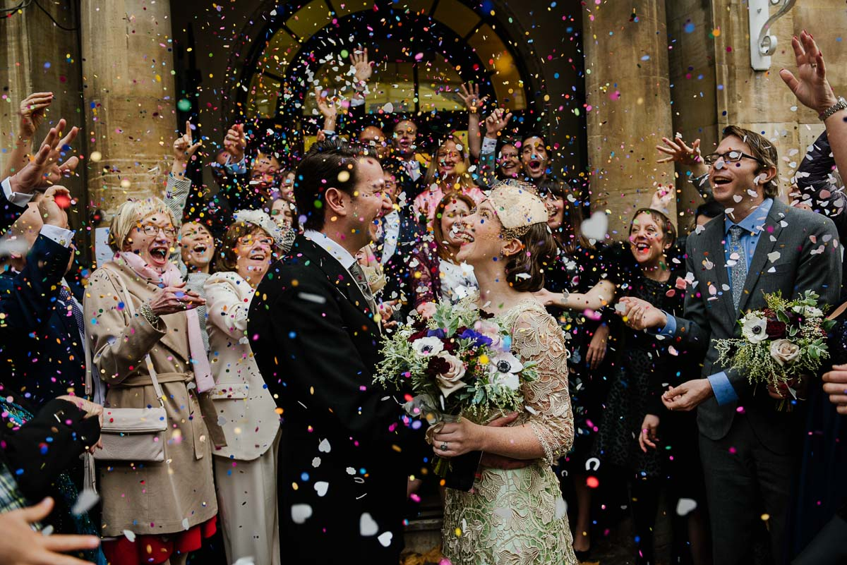 Fun and colourful confetti shower the bride and groom
