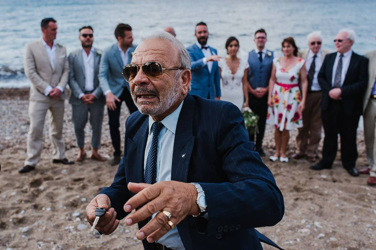 wedding guest panics on the beach holding car keys